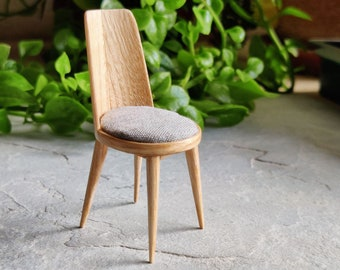Miniature upholstered chairs in ash wood.  Hand made in 1:12 scale. For dollhouse collectors and design lovers