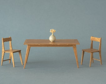 Miniature oak dining table in 1:12 scale. Suitable for dollshouse collectors