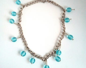 Adjustable handmade link bracelet with round blue beads