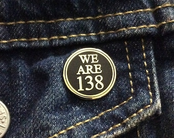 WE ARE 138 enamel pin