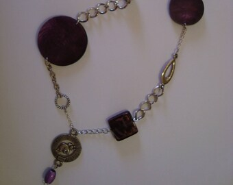Silver tone and purple elephant necklace