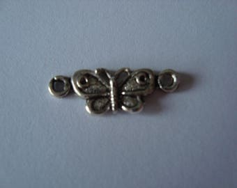 In between with a silver coloured metal Butterfly
