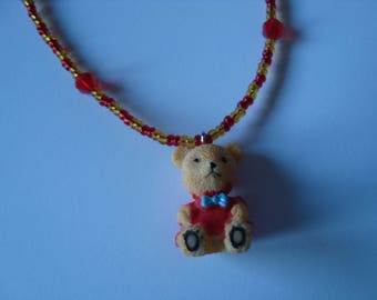 Red bear necklace with a blue bow