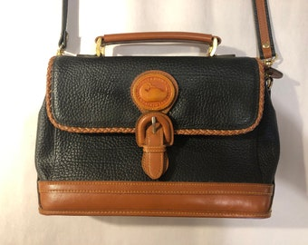e7203fb146 VTG 90 s Dooney   Bourke Black and Brown All Weather Leather Pebbled  Crossbody Hand Bag