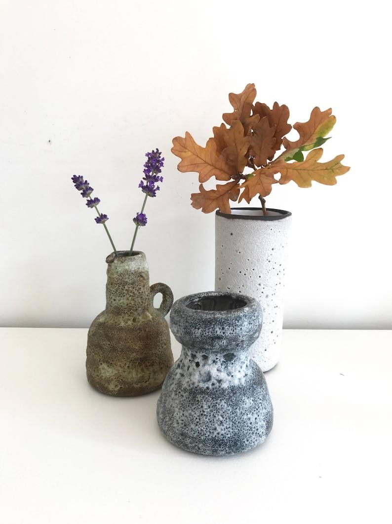 Set of three fat lava glazed vases by Vest ceramics from Gouda image 0
