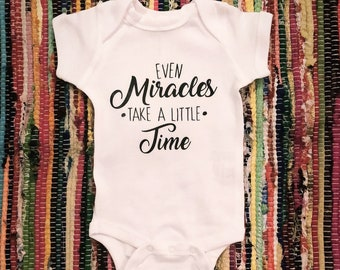 Baby Vest Even Miracles Take A Little Time coloured bodysuit