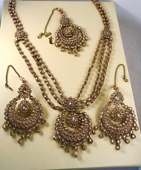 Joie Antique gold zirconia long necklace earrings and tikka set