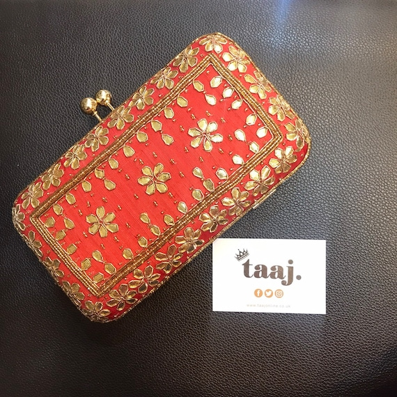 Kaye red and gold colour pill box style evening clutch bag.
