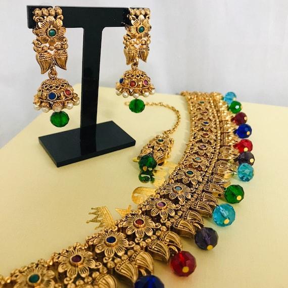 Clara Gold multi colour pearl choker necklace jhumka earrings and tikka set Indian bridal Pakistan jewellery