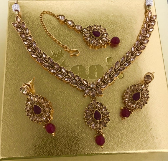 Hazoor Gold and ruby colour zirconia necklace earrings and tikka set, Indian bridal Pakistani jewellery