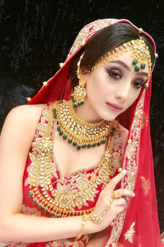 Raveena 8 piece gold and green kundan Indian bridal jewellery set