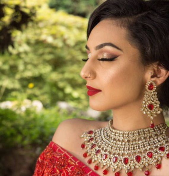 Raman Large Antique gold and red choker earrings and tikka set.