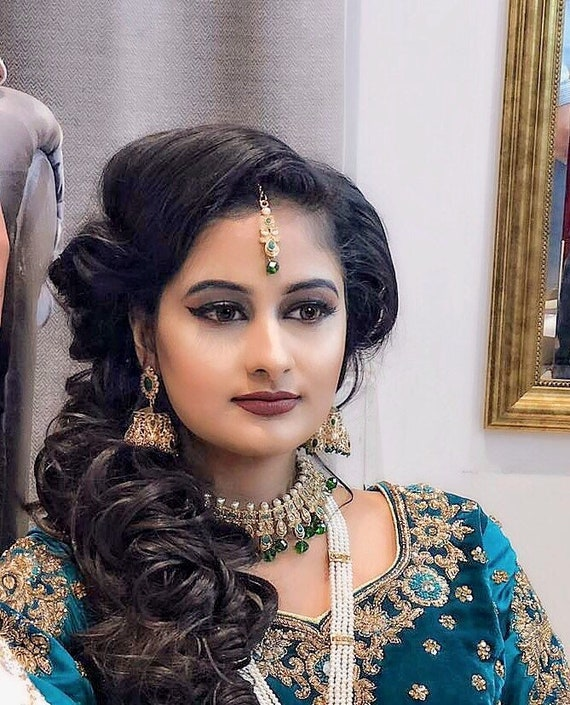 Risha Green and gold pearl choker necklace jhumka earrings tikka set