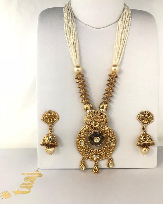 Amada Gold kundan effect pearl mala necklace and jhumka earrings, indian bridal partywear