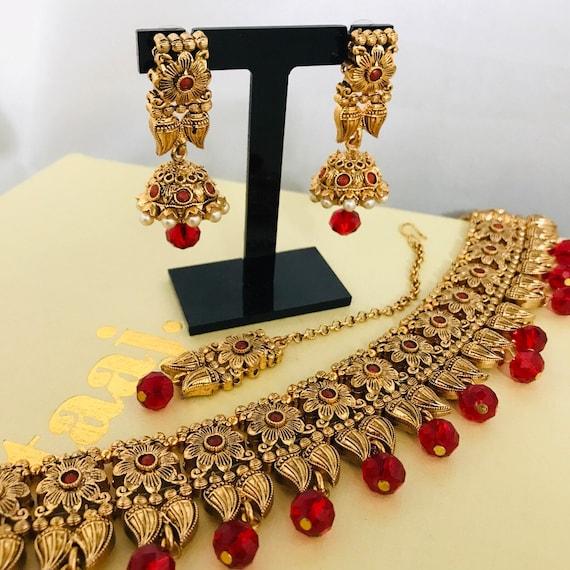 Clara Gold and red choker necklace jhumka earrings & tikka set