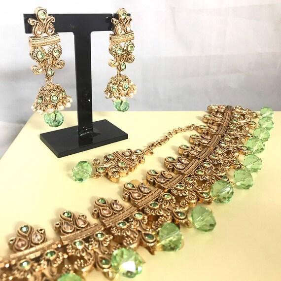 Zelda Gold pastel green pearl choker necklace jhumka earrings tikka set
