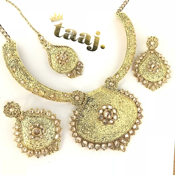 Shilpa Gold traditional Indian pendant necklace earrings and tikka set
