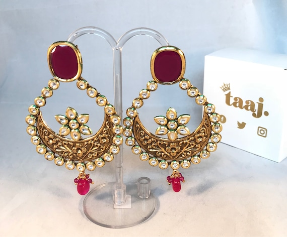 Dipyum Kundan large chaand bali earrings.