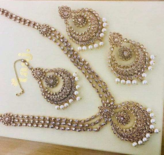 Joie Gold & pearl zirconia long rani haar necklace earrings and tikka set