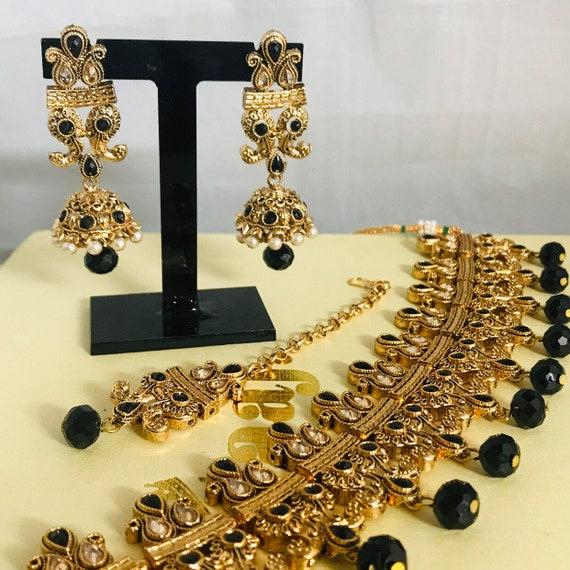 Zelda Gold and black pearl choker necklace jhumka earrings and tikka set