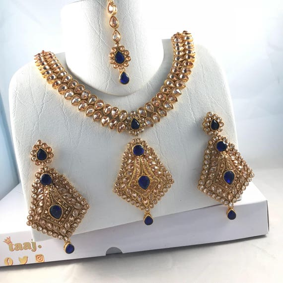 Jhanvi Gold and Sapphire blue zirconia Necklace earrings and tikka set.
