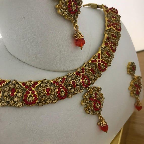 Aloka Gold & red diamanté Necklace Earring and tikka set
