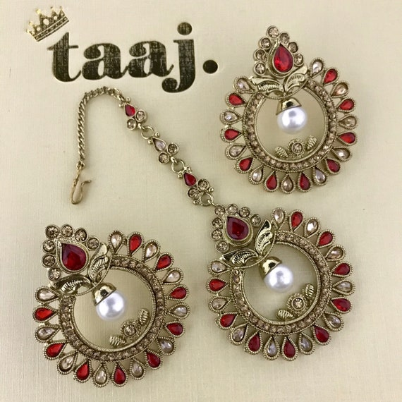 Bhumi Antique gold & red pearl earrings and tikka set.