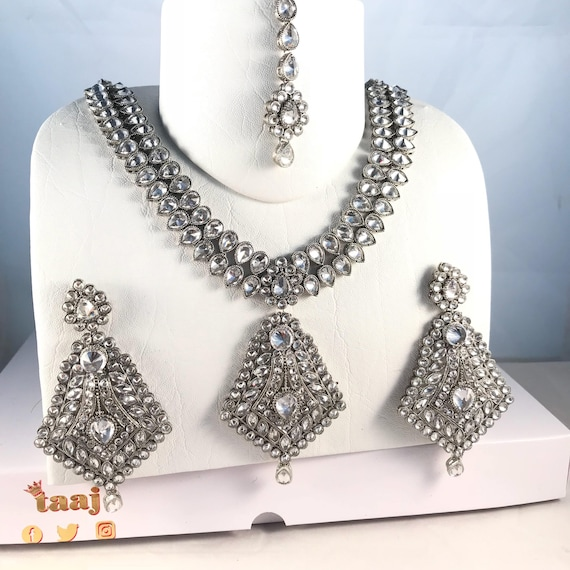 Jhanvi Silver zirconia necklace earrings and tikka set