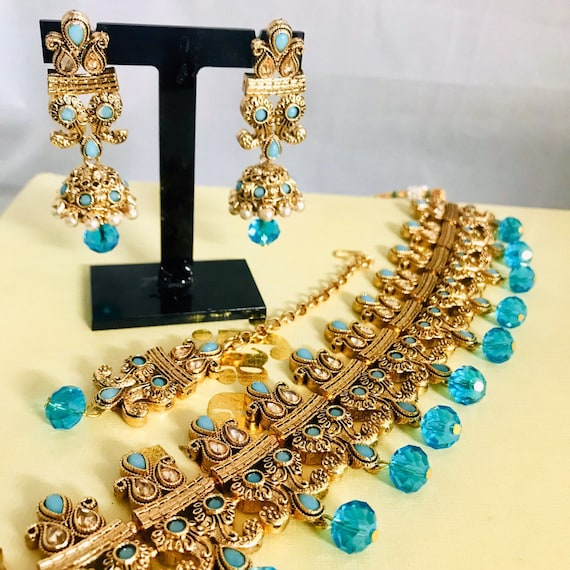 Zelda Gold firoza blue zirconia pearl choker necklace jhumka earrings and tikka set Indian bridal Pakistani jewellery