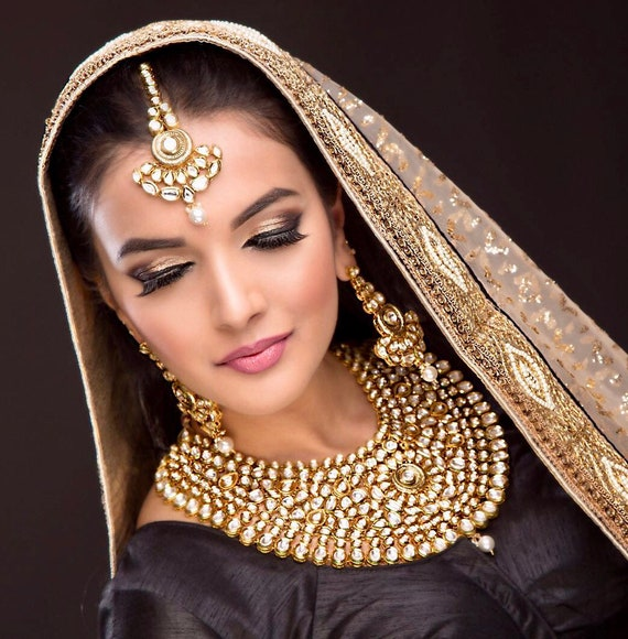 Deepika Gold plated kundan statement necklace earrings and tikka set