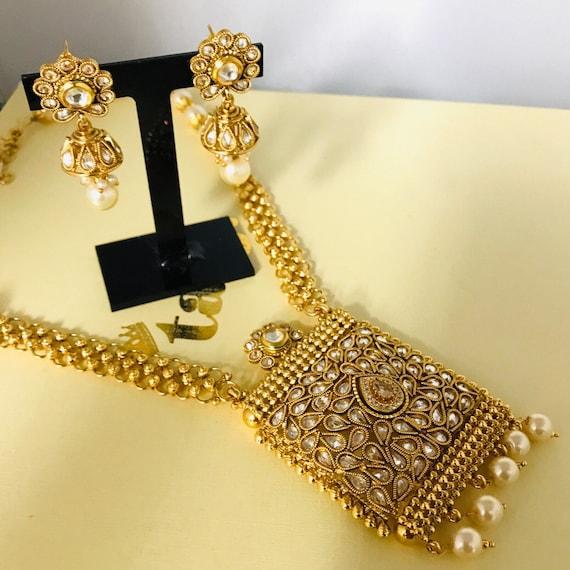 Runa Gold pearl kundan mala necklace jhumka earrings