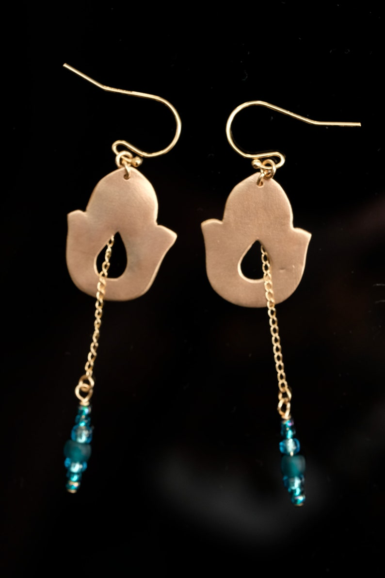 Earrings color Gold Handmade in solid bronze. chain and gold image 0