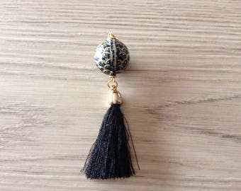 Bead patterns scales and black tassel pendant
