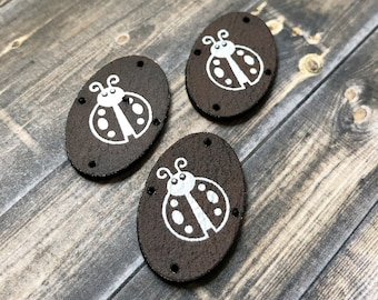 Sewed garments Leatherette garment tag for Crocheted METALLIC SILVER on Black Leatherette Oval Laser Etched tag Custom Tag Knitted