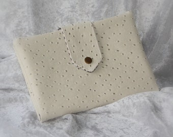 Wallet is faux leather ivory ostrich card