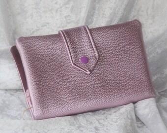 Wallet is faux leather purple card