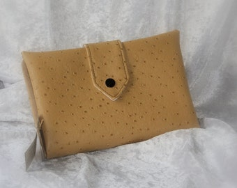 Wallet is faux leather camel ostrich card