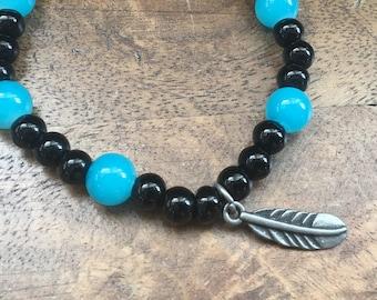 Handmade black and turn. feather charm bracelet