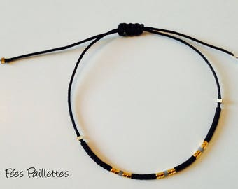 Bracelet made of black jade wire and Japanese glass beads gold plated, black and gray