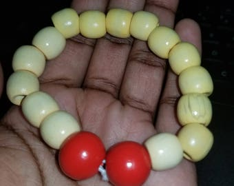 Beige and light yellow bracelet with red accent