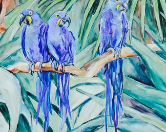 Three blue birds parrots on a branch with forest background