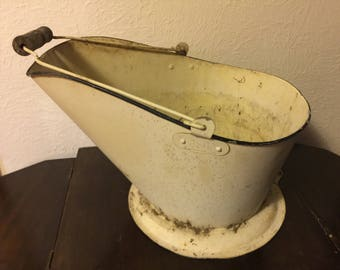 Old bucket wood handle-planter-yard item. Vintage bucket-storage-rustic-flower arrangement.