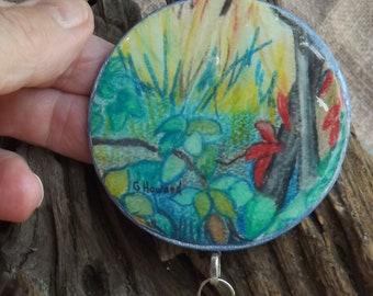 Signed Miniature Watercolour Disk of Leaves with Tassel ,colours of Spring, disk with a tassel of gold and silver chain