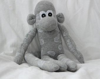 Grey patterned sock monkey