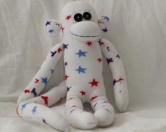 White and multi-coloured stars sock monkey