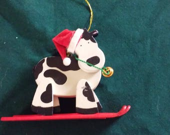 Avon Holly Jolly Skiing Cow Ornament