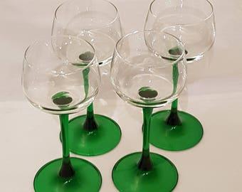 Four, green stemmed glasses