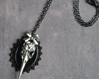 Romantic Gothic black necklace, cabochon and silver metal bird skull