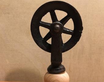 Wine bottle topper / cork.  Vintage metal pulley.