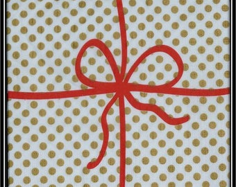 towel in red gold dots paper and bow